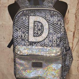 "Justice blue & silver sequinned ""D"" bookbag"